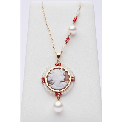 Red and white charm with cameo