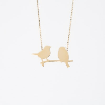 Necklace with two birds sitting on a branch